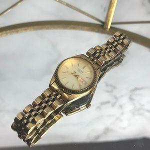 Pulsar quartz watch gold color